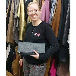 THE LONDON LEATHER WORKSHOP - one of our lovely students with her folded clutch